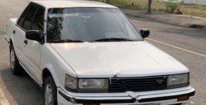 Cần bán Nissan Bluebird 1.8 đời 1990, màu trắng, xe nhập số sàn giá 18 triệu tại Tp.HCM