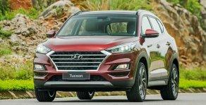 Hỗ trợ mua xe trả góp lãi suất thấp chiếc xe Hyundai Tucson 2.0L máy xăng, tiêu chuẩn, màu đỏ giá 774 triệu tại Tp.HCM