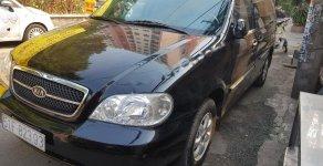Bán ô tô Kia Carnival 2008, màu đen số tự động, giá tốt giá 193 triệu tại Tp.HCM