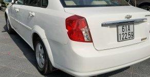 Cần bán Chevrolet Lacetti 1.6 MT đời 2013, màu trắng, 205tr giá 205 triệu tại Bình Dương