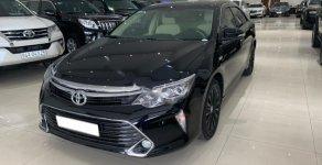 Bán Toyota Camry 2.0E năm sản xuất 2019, màu đen giá 950 triệu tại Tp.HCM