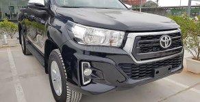 Thanh lý xe cuối cùng: Toyota Hilux 2.4E đời 2019, màu đen, số tự động giá 662 triệu tại Hà Nội