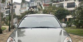 Cần bán gấp Kia Carens 2.0MT sản xuất năm 2010, màu xám xe gia đình giá 280 triệu tại Hà Nội