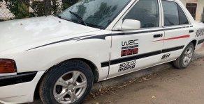 Bán ô tô Mazda 323 đời 1995, màu trắng giá 48 triệu tại Bình Định