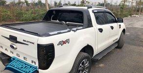 Cần bán Ford Ranger Wildtrak 3.2L 4x4 AT 2016, màu trắng, nhập khẩu nguyên chiếc giá 725 triệu tại Hà Nội