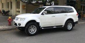 Cần bán lại xe Mitsubishi Pajero sản xuất năm 2014, màu trắng số tự động giá 665 triệu tại Tp.HCM