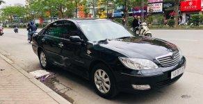 Bán Toyota Camry 3.0 năm sản xuất 2003, màu đen, số tự động  giá 265 triệu tại Hà Nội